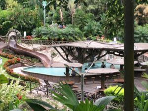 People playing in water slide and pool at Los Lagos Spa Resort in Costa Rica.